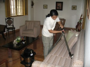 HOUSEKEEPING_(using_vacuum_cleaner)